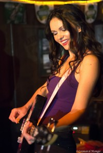 Natasha Blasick on bass guitar live with Snowflakes